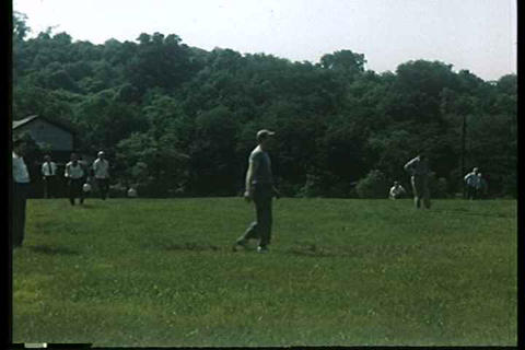 Men play baseball in this 1949 home movie Footage