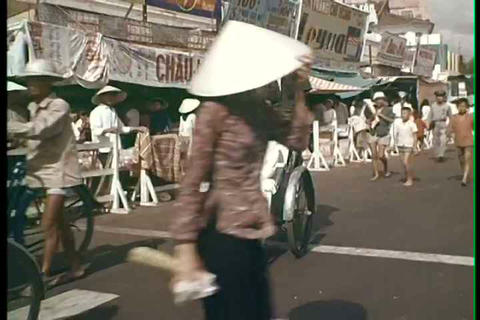 A montage of Saigon life in the 1960s during the V Footage