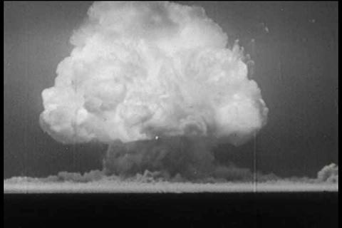 Atomic bomb blast footage followed by shot of dest Footage
