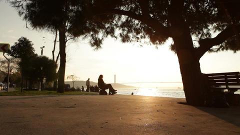 Sunset time lapse silhouettes on seashore Footage