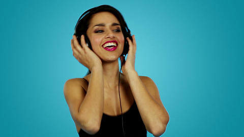close-up of beautiful woman wearing headphones Footage