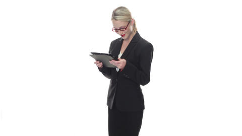 Stylish businesswoman holding a tablet Footage