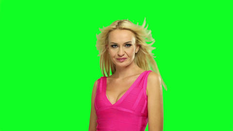 Blond woman dancing, on chroma green background Footage