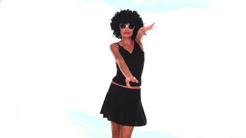 Funny woman dancing wearing African wig Footage