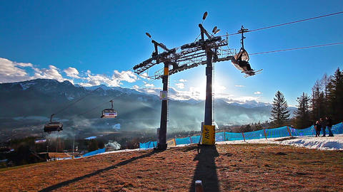 mountain landscape and skiers on a ski lift pov Footage