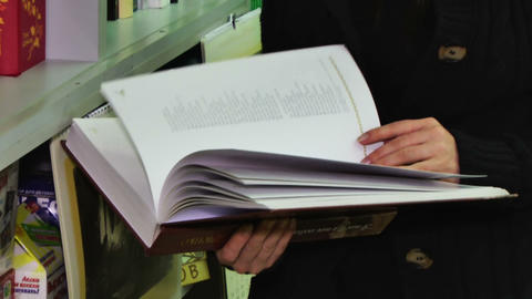 Book In Hands stock footage