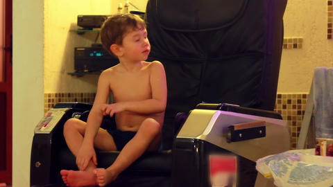Boy on Massage Chair 1 Footage