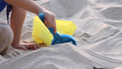 Girl playing sand Footage