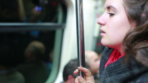 Sleepy Woman travelling inside metro Footage