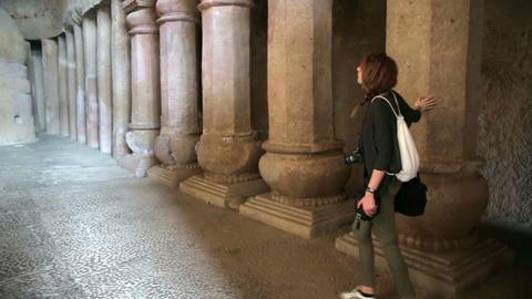 Female tourist visiting Hindu temple Footage