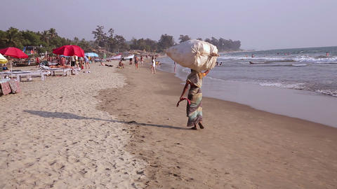 Carrying bag along sandy beach Footage