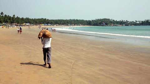 People walking along beach Footage