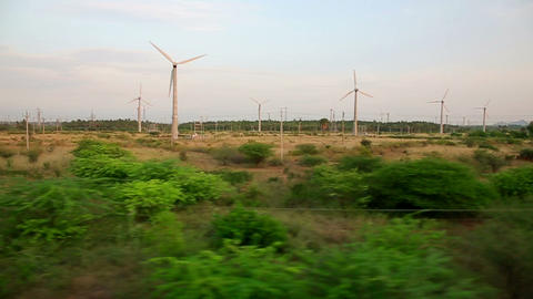 Train passing by wind farm Footage