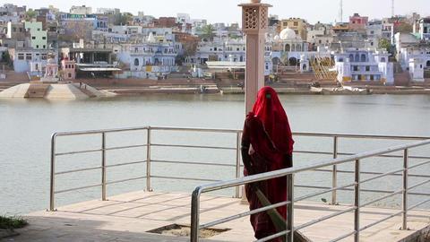 Woman swiping jetty, Pushkar, India Footage