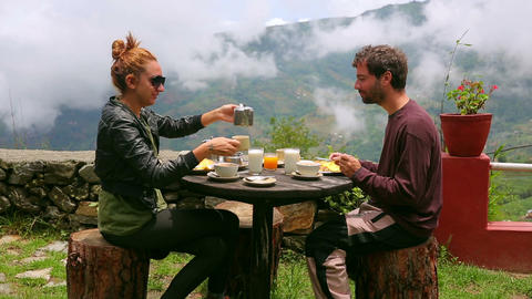 Tourist couple eating breakfast at himalayas mount Footage