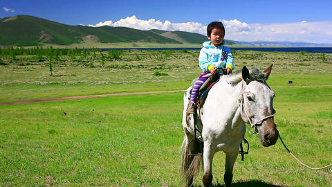 Young girl on horseback in Mongolian landscape Footage