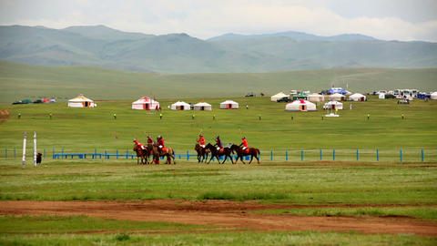 Men playing polo during Naadam Festival Footage