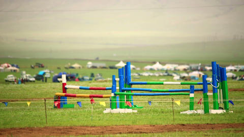 horse hurdle jumping during Naadam Festival Footage