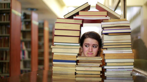 Girl gazing through books Footage