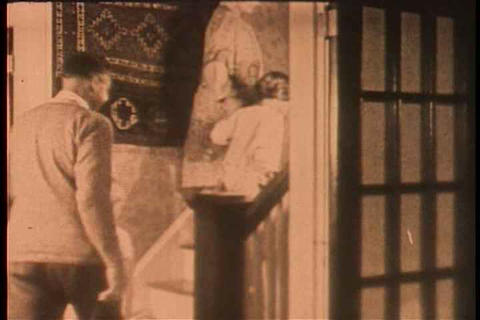 A home movie style shots circa 1915 of a happy fam Footage