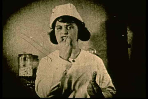 Archival silent film of a schoolmarm instructing c Footage