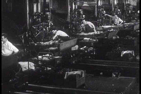 Very good factory shots of machine guns being prod Footage