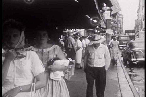 The Elderly Wander The Streets In 1950's St. Louis stock footage