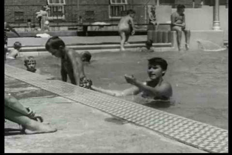 Children swim in a pool during summer and practice Live Action