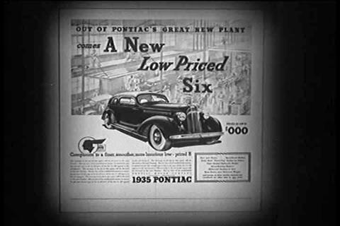 A family discovers the new Pontiac Ad in a newspap Footage