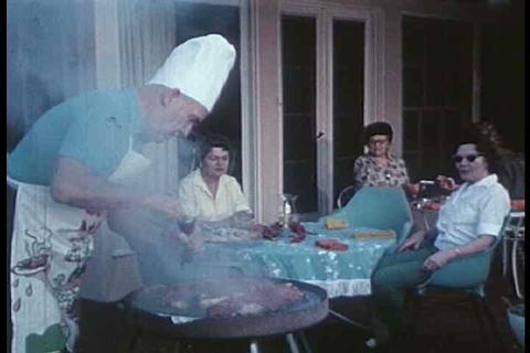 A backyard steak BBQ with older guests is shown Live Action