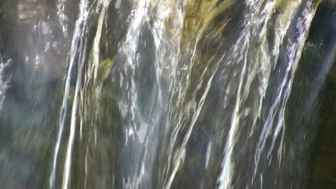 Closeup shot of water flowing over the edge (High... Stock Video Footage