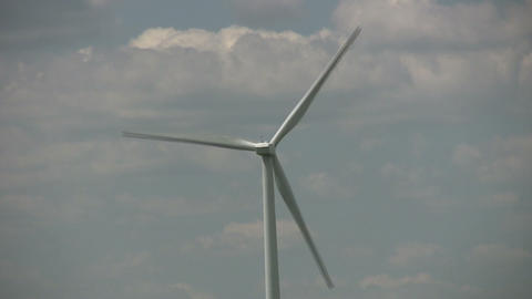 Wind turbine spin amidst a cloudy sunny day (High... Stock Video Footage