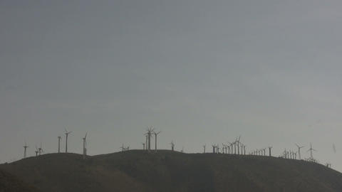 Wind turbines spin in the wind Stock Video Footage