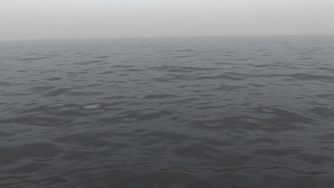 Ocean waves are gently rolling along in the haze... Stock Video Footage