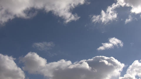 Timelapsed clouds slowly drift and change shapes (High... Stock Video Footage
