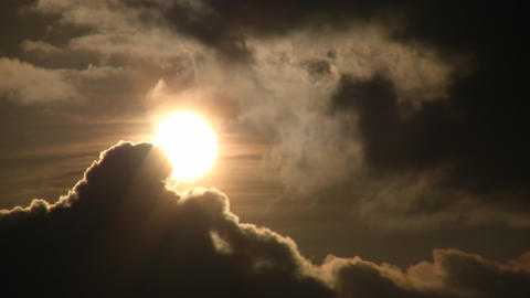 Beautiful timelapsed clouds slowly drift against the sun (High Definition) Footage