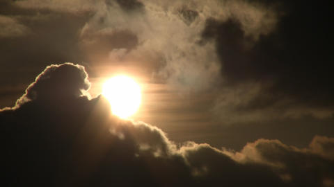 Beautiful timelapsed clouds slowly drift against the sun... Stock Video Footage