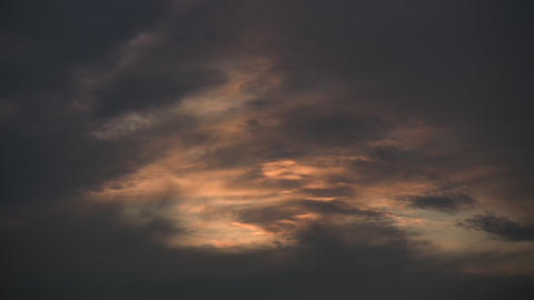 Timelapsed clouds slowly drift at dusk (High Definition) Stock Video Footage