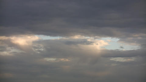 Timelapsed clouds slowly drift amidst the sky (High... Stock Video Footage