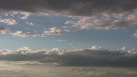 Timelapsed clouds slowly drift amidst a blue sky (High Definition) Live Action
