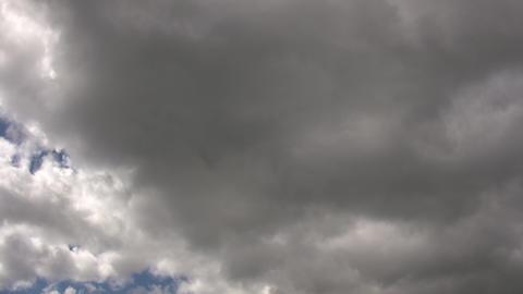 Dark clouds slowly drift in the gloomy sky (High Definition) Footage