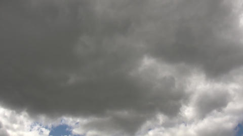Dark clouds slowly drift in the gloomy sky (High Definition) Footage