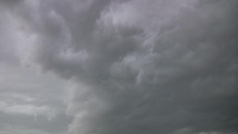 Dark timelapsed clouds drift by, brewing a storm (High Definition) Footage
