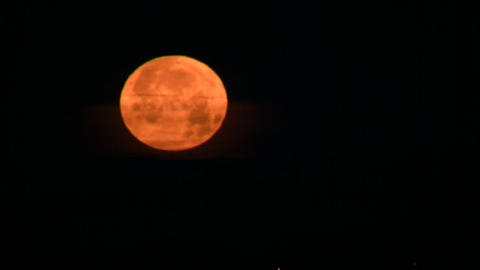 Night scenic of full moon, setting in horizon (High... Stock Video Footage