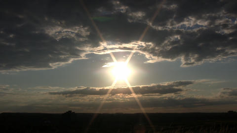 Clouds slowly drif by amidst the evening sun (High... Stock Video Footage