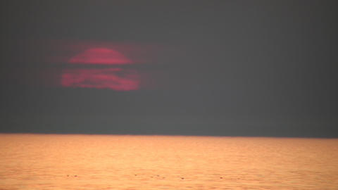Scenic of a faint sunset over the water (High Definition) Footage