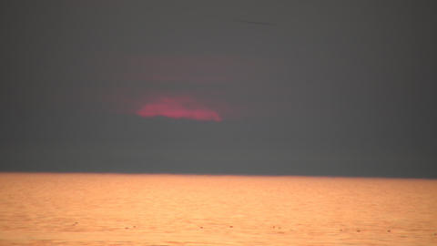 Scenic of a faint sunset over the water (High Definition) Stock Video Footage