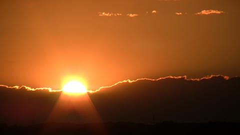 Scenic of a beautiful sunset admist the clouds (High Definition) Footage