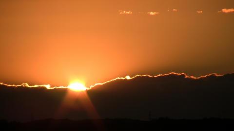 Scenic of a beautiful sunset admist the clouds (High... Stock Video Footage