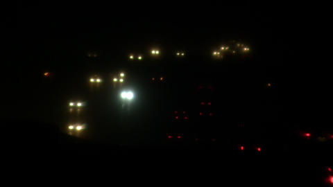 Headlights and taillights on busy highway at night (High Definition) Footage